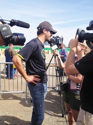 Luke Bryan stopping to talk to the press before shooting some targets.